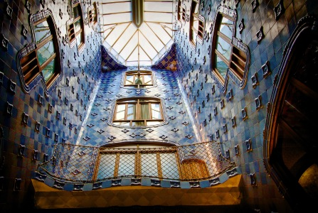 The blue light well. The tiles get darker in color as they go higher. Probably to brighten up the lower levels even more.