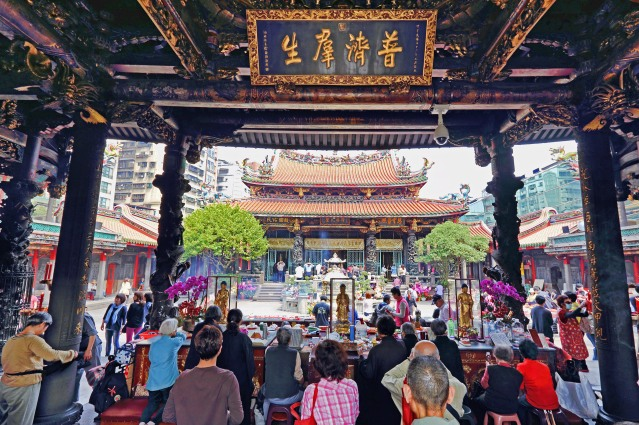 Worshipers throng the temple daily