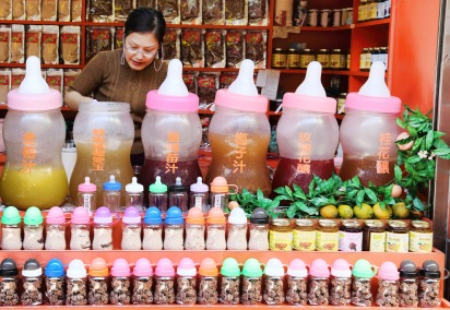Various drinks and preserved plums in quirky containers. Ice jelly is a hot favourite in Taipei, and a godsend in hot weather.