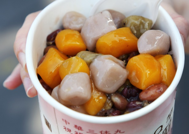 Yam and sweet potato balls on a bed of shaved ice and sweet red beans. Chewy.