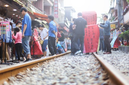 Bustling lantern lighting along the railway