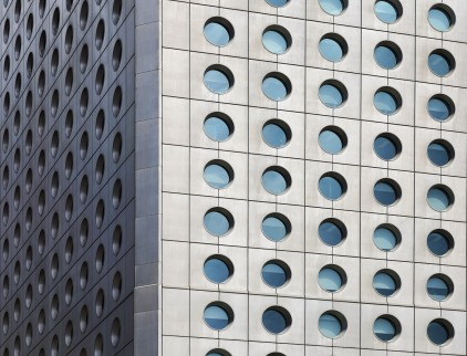 Jardine House in Hong Kong. Legend has it that it's also known as the house of a thousand buttholes